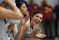 Elkins players cheer, Friday, February 14, 2020 during a basketball game at Elkins High School in Elkins. Check out nwaonline.com/prepbball/ for today's photo gallery.<br /> (NWA Democrat-Gazette/Charlie Kaijo)