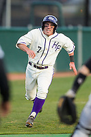 Dane McDermott (7) of the High Point Panthers hustles towards home plate on his way to scoring a run against the Coastal Carolina Chanticleers at Willard Stadium on March 15, 2014 in High Point, North Carolina.  (Brian Westerholt/Four Seam Images)
