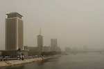 Buildings are engulfed in sand storm in Cairo, Egypt, March 3, 2014. A sand storm hit Cairo on Sunday. Photo by Mohammed Bendari