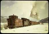 A K-36 pushing a box car freight East of Chama. Caboose #0574 is the tail end.<br /> D&amp;RGW  e. of Chama, NM  Taken by Gildersleeve, Thomas H.