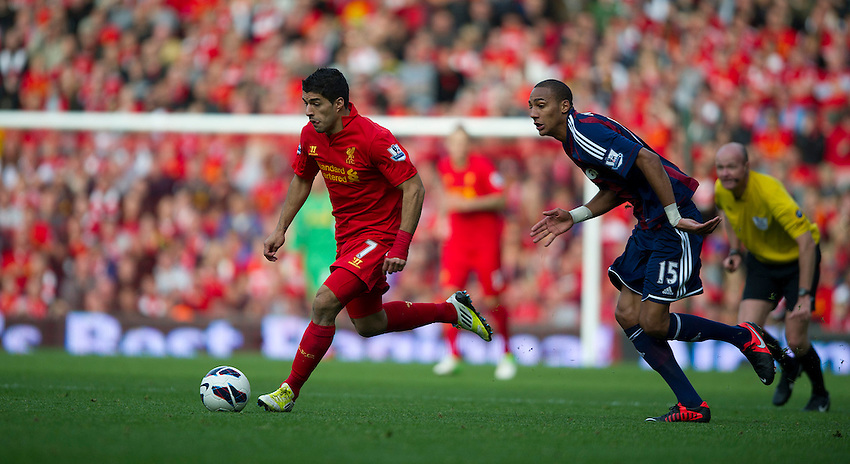 Liverpool's Luis Suarez and Stoke City's Steven N'Zonzi ..Football - Barclays Premiership - Liverpool v Stoke City - Sunday 7th October 2012 - Anfield - Liverpool..