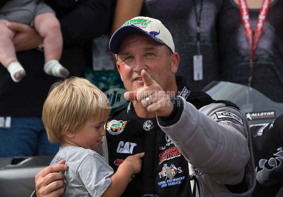 Apr. 28, 2013; Baytown, TX, USA: NHRA top fuel dragster driver Bob Vandergriff Jr celebrates with his son after winning the Spring Nationals at Royal Purple Raceway. Mandatory Credit: Mark J. Rebilas-