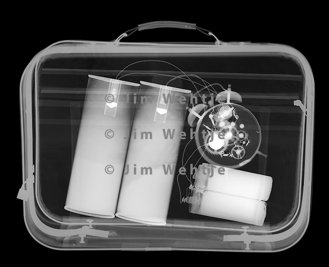 X-ray image of a bomb in a suitcase (white on black) by Jim Wehtje, specialist in x-ray art and design images.