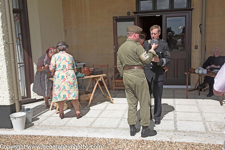 People in nineteen forties roles at a Living History event