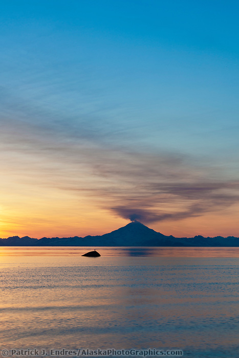 Plume of gas and vapor vent from the summit of Mt. Redbout volcano (10,191 ft), of the chigmit mountains, aleutian range. view across Cook Inlet approximately 50 miles, at sunset, southcentral, Alaska.