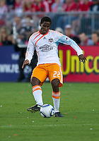 01 July 2010:  Houston Dynamo midfielder Lovel Palmer #22 in action during a game between the Houston Dynamo and the Toronto FC at BMO Field in Toronto..Final score was 1-1....