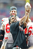 Ohio State Buckeyes running back Ezekiel Elliott (15) lifts a portion of the Fiesta Bowl trophy for the crowd to see after their victory over Notre Dame 44-28 at University of Phoenix Stadium in Glendale, AZ on January 1, 2016.  (Chris Russell/Dispatch Photo)