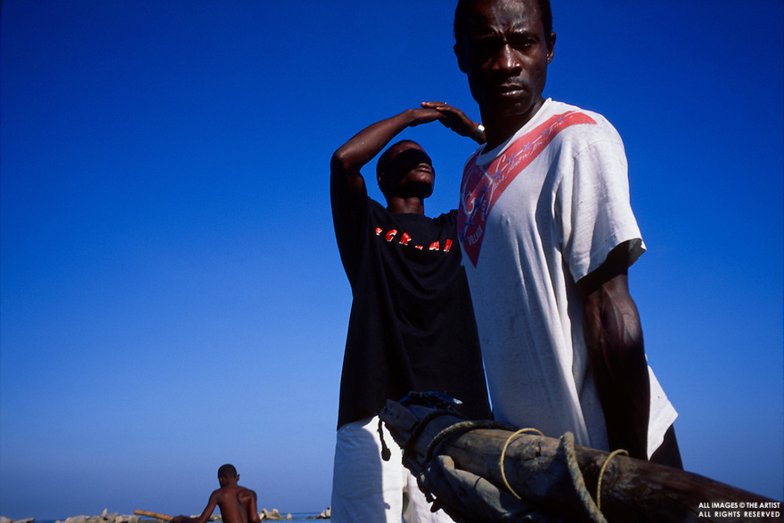 Haitian fisherman raise the mast of a small boat in Port-au-Prince, Haiti in September, 2000.