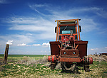 This photo was taken during one of my many Photo Walk About's I came across this old farm tractor left out in the field it problem once plowed. This photos was taken in Lancaster California April 19, 2014 ©Fitzroy Barrett