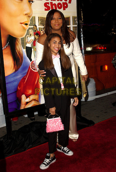 "PAIGE HURD & QUEEN LATIFAH.MGM's World Premiere of ""Beauty Shop"" held at The Mann National Theater in Westwood, California.March 24th, 2005.full length black suit pink purse bag tuxedo converse trainers sneakers.www.capitalpictures.com.sales@capitalpictures.com.Supplied By Capital PIctures"