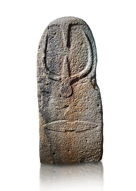 Late European Neolithic prehistoric Menhir standing stone with carvings on its face side. The representation of a stylalised male figure starts at the top with a long nose from which 2 eyebrows arch around the top of the stone. below this is a carving of a falling figure with head at the bottom and 2 curved arms encircling a body above. at the bottom is a carving of a dagger running horizontally across the menhir. Excavated from Bau Carradore II, Laconi. Menhir Museum, Museo della Statuaria Prehistorica in Sardegna, Museum of Prehoistoric Sardinian Statues, Palazzo Aymerich, Laconi, Sardinia, Italy. White background.