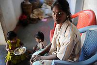 """INDIA Tamil Nadu Dindigul, portraits of young women which have worked in spinning units under the Sumangali scheme, a contract system, in which they are exploited instead of receiving a training and often do not receive the promised salary at the end of the contract / INDIEN Tamil Nadu, Dindigul , Portraets von Frauen die in der Textilindustrie in Spinnereien im Sumangali System gearbeitet haben, Sumangali bedeutet """"glueckliche Braut"""" und ist eine Form von Zwangsarbeit, junge Frauen erhalten einen Vertrag mit Versprechen auf Ausbildung und Zahlung einer Einmalsumme zum Ende der Laufzeit, sie arbeiten oft unter menschenunwuerdigen Bedingungen, werden teilweise sexuell von Vorarbeitern belaestigt und erhalten in vielen Faellen nicht die versprochene Entlohnung, Maedchen Shitra 19 Jahre aus Dorf Brantilaiparai hat in einer Spinnerei gearbeitet und keine Bezahlung zum Ende ihres Vertrages bekommen"""