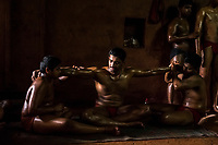Kushti wrestlers massage each other on their day off at Gangavesh Talim on the 17th of September, 2017 in Kolhapur, India.  <br /> Photo Daniel Berehulak for Lumix