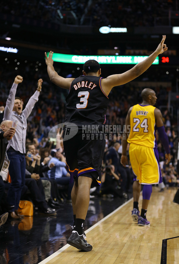 Jan. 30, 2013; Phoenix, AZ, USA: Los Angeles Lakers guard Kobe Bryant (24) walks away as Phoenix Suns forward Jared Dudley (3) celebrates a fourth quarter three pointer at the US Airways Center. The Suns defeated the Lakers 92-86.  Mandatory Credit: Mark J. Rebilas-