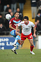 Ronnie Henry of Stevenage heads clear from Andy Barcham of Scunthorpe. Scunthorpe United v Stevenage - npower League 1 - Glanford Park, Scunthorpe - 21st January, 2012. © Kevin Coleman 2012