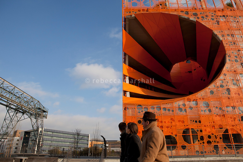 """La Confluence district, Lyon, France, 14 January 2012. """"Head towards the postmodernist building resembling a block of orange cheese"""""""