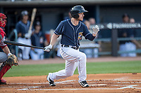 Toledo Mud Hens outfielder Alex Presley (3) follows through on his swing against the Louisville Bats during the International League baseball game on May 17, 2017 at Fifth Third Field in Toledo, Ohio. Toledo defeated Louisville 16-2. (Andrew Woolley/Four Seam Images)