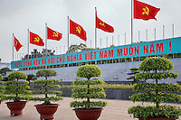 "Vietnam. Hanoi. Outside Ho Chi Minh's Mausoleum float in the air six flags of the Vietnamese Communist Party. Alphabet and writings in vietnamese language say:  "" Long life to the Communist Party. Ho Chí Minh (May 19, 1890 - September 2, 1969) was a Vietnamese Communist revolutionary, who led the Viet Minh independence movement from 1941 onward, statesman as Prime Minister (1946-1955) and President (1946-1969) of the Democratic Republic of Vietnam (North Vietnam). 04.04.09 © 2009 Didier Ruef"