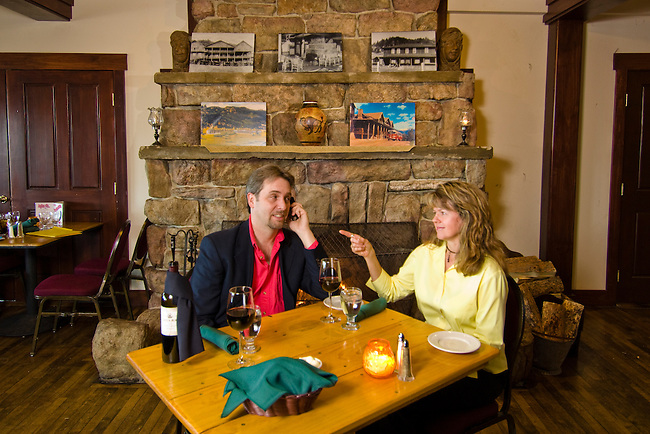 couple enjoys dining in a rustic restaurant, not released