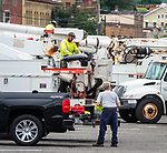 TORRINGTON , CT-080720JS04—Electrical contractor from State Electric Corporation, a company based in Massachusetts, stage their trucks and personnel at the Torrington Plaza on South Main Street in Torrington on Friday morning. <br /> Jim Shannon Republican-American
