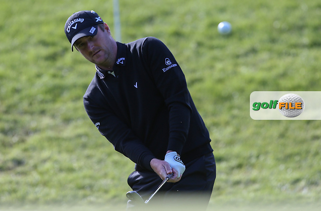 Marc Warren (SCO) chips to the 17th  during the Pro-Am ahead of the 2015 BMW PGA Championship over the West Course at Wentworth, Virginia Water, London. Picture David Lloyd, www.golffile.ie: 20/05/2015