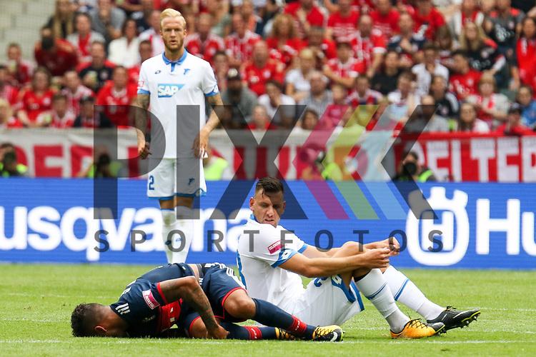 Muenchens Tolisso (Nr.24) gefault von Hoffenheims Eugen Polanski (Nr.8)  beim Telekom Cup 2017 Bayern Muenchen - TSG Hoffenheim.<br /> <br /> Foto &copy; PIX-Sportfotos *** Foto ist honorarpflichtig! *** Auf Anfrage in hoeherer Qualitaet/Aufloesung. Belegexemplar erbeten. Veroeffentlichung ausschliesslich fuer journalistisch-publizistische Zwecke. For editorial use only.