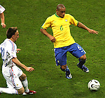 01 July 2006: Roberto Carlos (BRA) (6) beats Frank Ribery (FRA) (22) to the ball. France defeated Brazil 1-0 at Commerzbank Arena in Frankfurt, Germany in match 60, a Quarterfinal game of the 2006 FIFA World Cup.