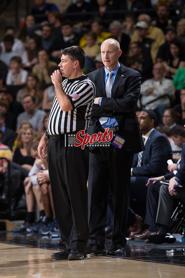Xavier Musketeers head coach Chris Mack stares at referee Pat Driscoll during second half action against the Wake Forest Demon Deacons at the LJVM Coliseum on December 22, 2015 in Winston-Salem, North Carolina.  The Musketeers defeated the Demon Deacons 78-70.  (Brian Westerholt/Sports On Film)