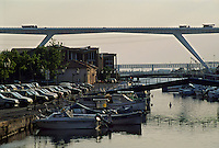Boats moored in a marina beneath a highway bridge, Martigues, Provence, France.