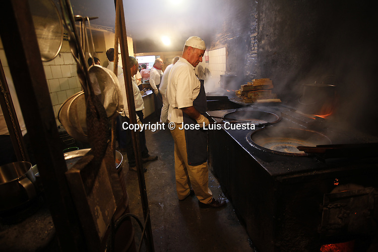 """At Churreria """"La Mañueta"""", churros are prepared at the same traditional way since more than five generations. These churros are a typical San Fermin breakfast after of the running bulls. San Fermin festival is worldwide known because the daily running bulls."""