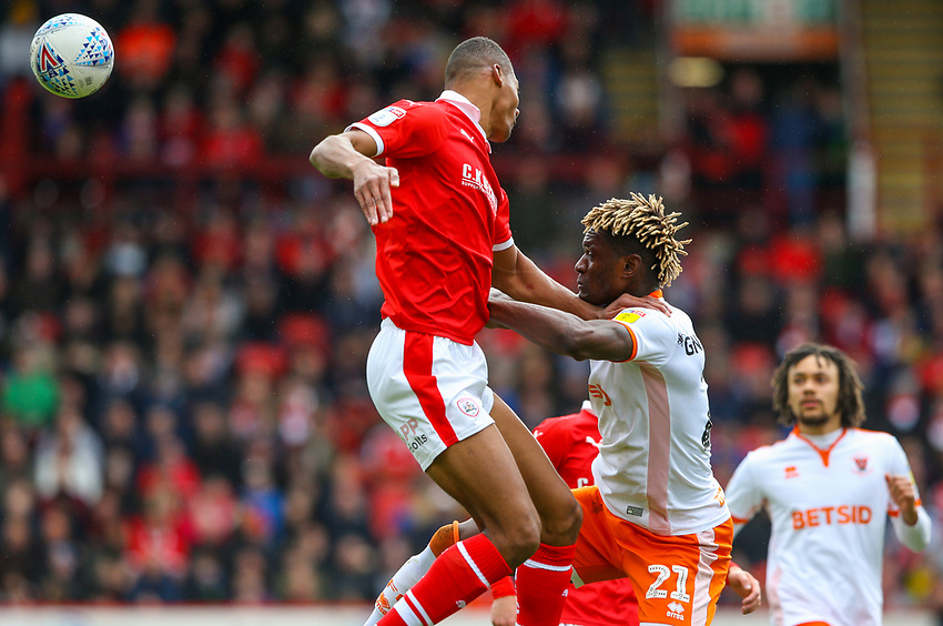 Blackpool's Armand Gnanduillet battles with Barnsley's Ethan Pinnock<br /> <br /> Photographer Alex Dodd/CameraSport<br /> <br /> The EFL Sky Bet League One - Barnsley v Blackpool - Saturday 27th April 2019 - Oakwell - Barnsley<br /> <br /> World Copyright © 2019 CameraSport. All rights reserved. 43 Linden Ave. Countesthorpe. Leicester. England. LE8 5PG - Tel: +44 (0) 116 277 4147 - admin@camerasport.com - www.camerasport.com