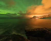Northern ligths mix with light pollution reflecting in clouds, Bleik, Vesterålen, Norway