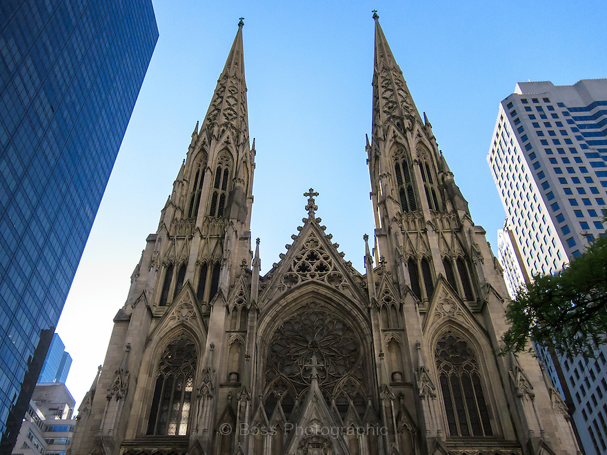 Spires of an old church juxtaposed against modern high-rise buildings, New York City
