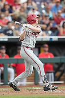 Arkansas Razorbacks outfielder Heston Kjerstad (18) hits an opposite field home run during Game 5 of the NCAA College World Series against the Texas Tech Red Raiders on June 17, 2019 at TD Ameritrade Park in Omaha, Nebraska. Texas Tech defeated Arkansas 5-4. (Andrew Woolley/Four Seam Images)