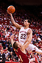 27 December 2011: Bo Spencer #23 of the Nebraska Cornhuskers fouls Ben Brust #1 of the Wisconsin Badgers as he goes for the lay up during the second half at the Devaney Sports Center in Lincoln, Nebraska. Wisconsin defeated Nebraska 64 to 40.