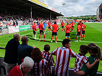 Lincoln City players warm-up in front of the fans <br /> <br /> Photographer Chris Vaughan/CameraSport<br /> <br /> The EFL Sky Bet League Two - Lincoln City v Morecambe - Saturday August 12th 2017 - Sincil Bank - Lincoln<br /> <br /> World Copyright &copy; 2017 CameraSport. All rights reserved. 43 Linden Ave. Countesthorpe. Leicester. England. LE8 5PG - Tel: +44 (0) 116 277 4147 - admin@camerasport.com - www.camerasport.com