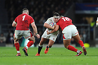 Jamie George of England is tackled by Leon Brown of Wales as Rob Evans of Wales supports during the Guinness Six Nations match between England and Wales at Twickenham Stadium on Saturday 7th March 2020 (Photo by Rob Munro/Stewart Communications)