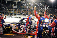 Nov. 13, 2009; Avondale, AZ, USA; NASCAR Camping World Truck Series driver Ron Hornaday celebrates with crew members after clinching the 2009 championship following the Lucas Oil 150 at Phoenix International Raceway. Mandatory Credit: Mark J. Rebilas-