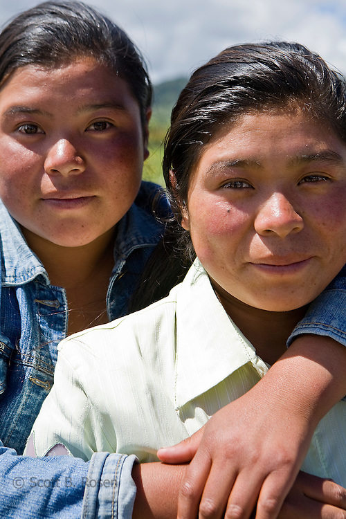 Two sisters pose together outside a church in San Nicolas, Western Highlands, Guatemala