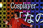 A Japanese cosplayer poses for a  online movie during the TOKYO NICONICO COSPLLECTION at the nicofarre, in the Roppongi clubing district in Tokyo, December 04, 2011. ..This event introduce Japanese Cosplay Culture through the unprecedented show which realizes a virtual world of Japanese Anime, game and Vocaloids. More than 100 famous cosplayers dressed as popular characters...Nico Nico Douga, Japanese online movie sharing service, launched nicofarre on 12 July n which LED monitors are installed on every wall and ceiling surface in order to generate virtual characters, landscapes, and user comments in a 360-degree setting. Those watching online can type in comments that are then scrolled in real time on the wall-screens of the main hall. (Photo by Tomoyuki Kaya/AFLO)