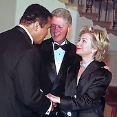 United States President Bill Clinton introduces former Heavyweight Champion Muhammad Ali to first lady Hillary Rodham Clinton at the White House Millennium dinner in Washington, D.C. on 31 December, 1999. (L-R) Muhammad Ali, President Clinton, Hillary Rodham Clinton.<br /> Credit: Ron Sachs / CNP