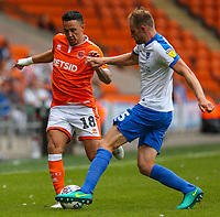 Blackpool's John O'Sullivan vies for possession with Portsmouth's Matt Clarke<br /> <br /> Photographer Alex Dodd/CameraSport<br /> <br /> The EFL Sky Bet League One - Blackpool v Portsmouth - Saturday August 11th 2018 - Bloomfield Road - Blackpool<br /> <br /> World Copyright &copy; 2018 CameraSport. All rights reserved. 43 Linden Ave. Countesthorpe. Leicester. England. LE8 5PG - Tel: +44 (0) 116 277 4147 - admin@camerasport.com - www.camerasport.com