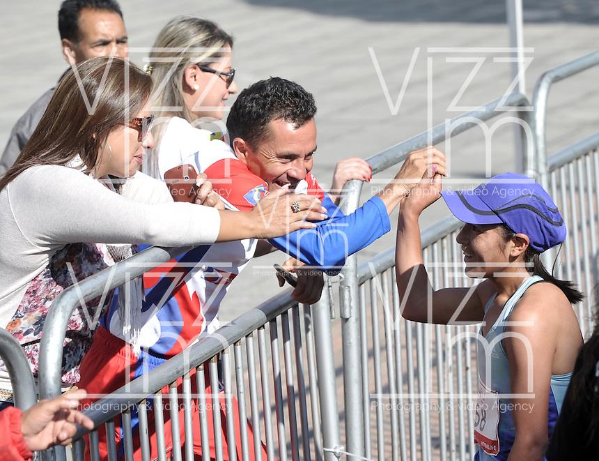 BOGOTA – COLOMBIA – 6-03-2013: Ines Melchor de Peru, en damas, se impuso en la tercera versión del Avianca RunTour 2015, cerca de 10000 atletas participaron, por las calles de Bogota. Avianca impulsado a promover el atletismo como deporte universal, al tiempo contribuye a la salud de los niños de escasos recursos económicos que requieren atención medica y quirúrgica especializada, es asi como Avianca entrega a la Fundacion Cardio Infantil los dineros recaudados para la dotación de la Unidad de Cuidados Intensivos de Neonatos. / Ines Melchor of Peru, in ladies, won the second version of Avianca RunTour 2014, nearly 10,000 athletes participated, through the streets of Bogota. Avianca driven to promote athletics as universal sport, while contributing to the health of children of low income who require specialized medical and surgical care, is also Avianca delivery to the Fundacion Cardio Infantil, the monies raised for the endowment of the unit Neonatal Intensive Care. Photo: VizzorImage / Luis Ramirez / Staff.