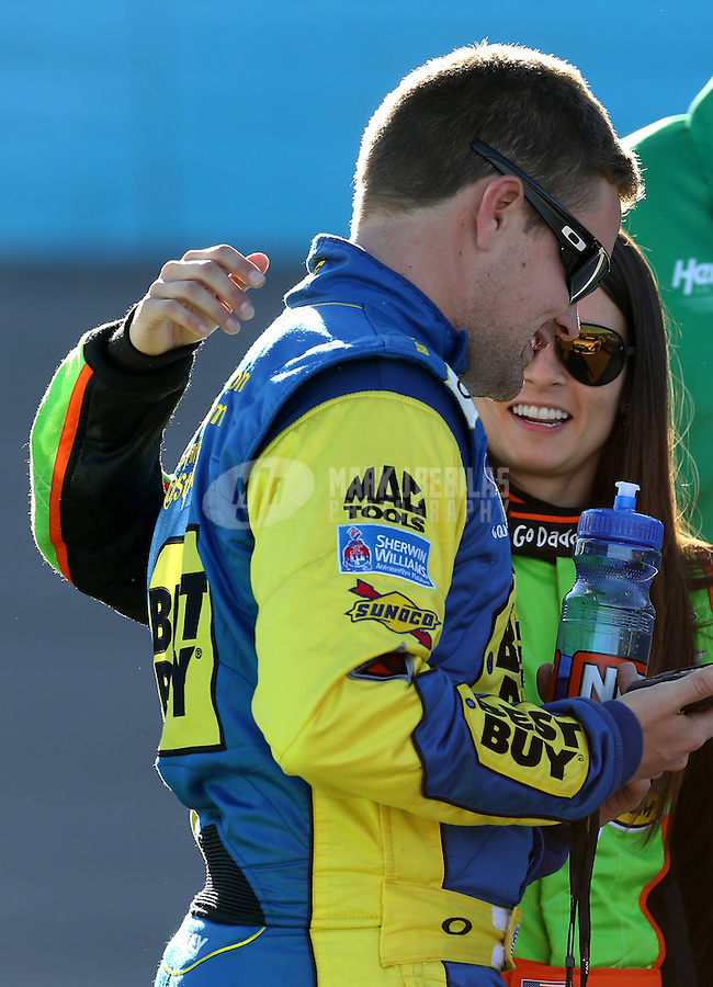 Mar. 1, 2013; Avondale, AZ, USA; NASCAR Sprint Cup Series driver Danica Patrick (right) with boyfriend Ricky Stenhouse Jr during qualifying for the Subway Fresh Fit 500 at Phoenix International Raceway. Mandatory Credit: Mark J. Rebilas-