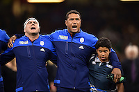 Guilhem Guirado and Thierry Dusautoir of France sing their national anthem. Rugby World Cup Pool D match between France and Ireland on October 11, 2015 at the Millennium Stadium in Cardiff, Wales. Photo by: Patrick Khachfe / Onside Images