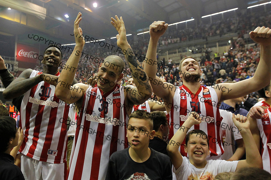 BELGRADE, SERBIA - DECEMBER 18: Quincy Miller (L)  Maik Zirbes (C) and Vladimir Stimac (R) of Crvena Zvezda Belgrade celebrate victory after the 2015-2016 Turkish Airlines Euroleague game between Crvena Zvezda Telekom Belgrade v FC Bayern Munich in Pionir Hall on December 18, 2015 in Belgrade, Serbia.  (Photo by Srdjan Stevanovic/Getty Images)