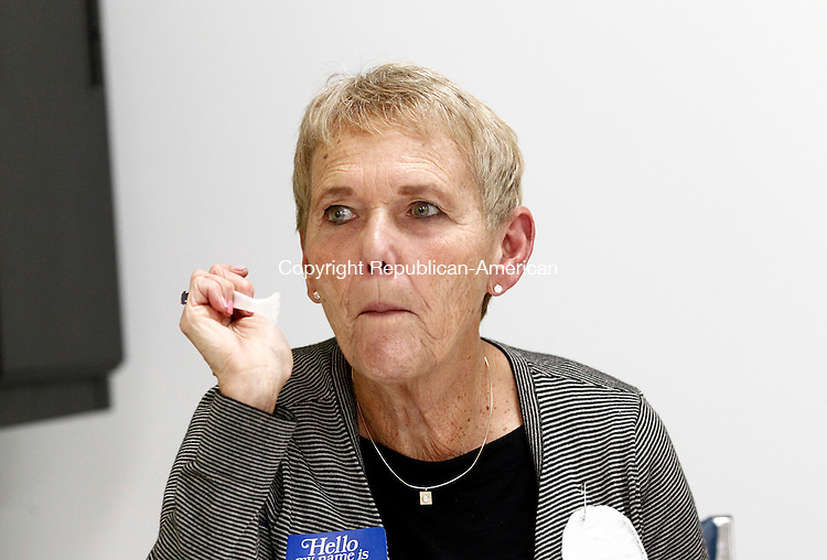 Middlebury, CT- 09 October 2014-100914CM02-  Ann Feinberg of Middlebury tastes a cupcake during the  Middlebury Public Library's 6th annual Bake Your Best Cupcake Contest on Thursday. There were 11 entries in the contest, which was sponsored by the Friends of the Middlebury Library.    Christopher Massa Republican-American
