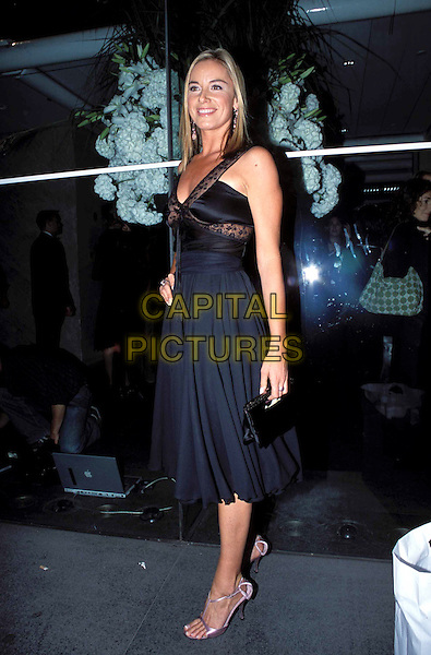 TAMZIN OUTHWAITE - TAMSIN OUTHWAITE.Lycra British Style Awards 2003, Old Billingsgate Market, EC3.black flowing dress, lace straps, full length, full-length.www.capitalpictures.com.sales@capitalpictures.com.© Capital Pictures