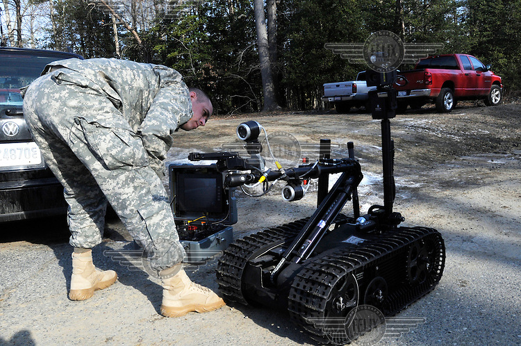 A soldier from the 22nd Chemical Battalion EOD (Explosive Ordnance Disposal) operates a robot used to secure and inspect suspected IED devices. A mechanical arm and video cameras and sensors allow these robots to give the soldiers a safe view and the ability to defuse or detonate bombs. At the Aberdeen Proving Ground, in Edgewood, Maryland, the US military and civilian contractors spearhead the fight against Improvised Explosive Devices (IEDs) the leading killer of US forces in Afghanistan.