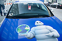A close up of the Michelin Man on a blue Audi car. This car took part in Audi's Mileage Marathon from New York to Los Angeles in October 2008. The event was put on to demonstrate Audi's TDI (turbocharged direct injection) system featuring ultra low emissions and high fuel efficiency.